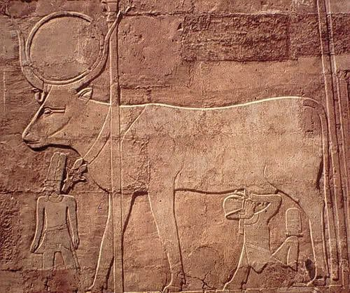 Hathor giving milk to Hatshepsut in the presence of Amun.